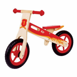 Bicycle without pedals in wood red